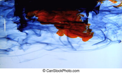 Blue orange and black ink swirling