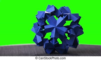 Blue origami spiky ball exposition. Green hromakey...