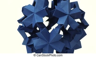 Blue origami transforming spiky ball. Bright isolated...