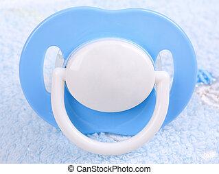 Blue pacifier, close-up