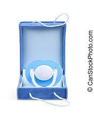 Blue pacifier in box