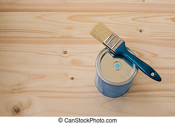 brush and paint - Blue paint and brush on wooden background,...