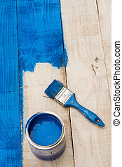 Blue paint on the wooden board planks