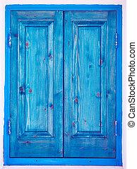 Blue painted wooden window shutters