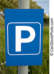 Blue Parking Lot Sign in Rural Setting