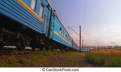 Blue passenger train. - Blue passenger train in movement.