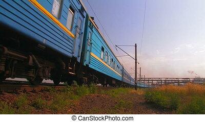 Blue passenger train. - Blue passenger train in movement.