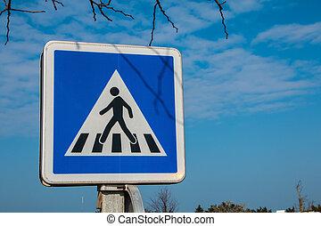 blue pedestrian crossing sign