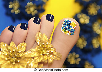 Blue pedicure with butterflies in white lacquer big toe with Golden flowers.