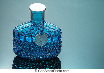 Blue perfume bottle with reflection on black mirror background