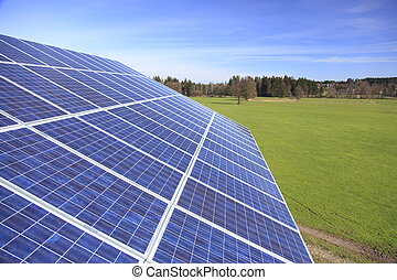 blue photovoltaic - Photovoltaic panels on roof top with...