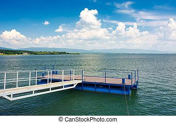blue pier on Zemplinska Sirava lake. beautiful landscape of...