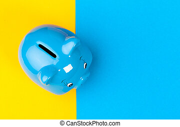Blue piggy bank money box on bright colored background
