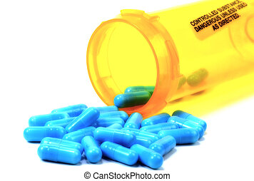 Blue Pills and a Pill Bottle With Blur Effect.