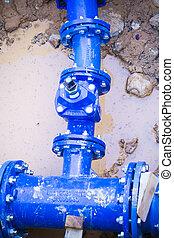 Blue pipe in the street damaged, repair