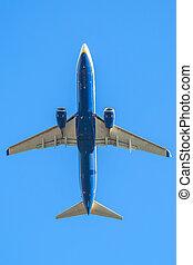 blue plane in the sky - blue passenger airplane flight...