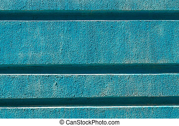 Blue plaster on the facade of a modern building background texture.