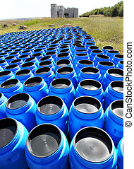 Blue plastic barrels for storing and transporting hazardous...