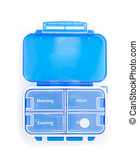 Blue plastic pill organizer Isolated on white background....