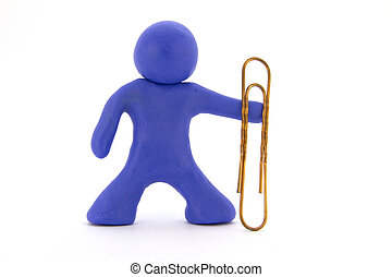 Blue plasticine character and big paperclip. Stationery. Isolated over white background