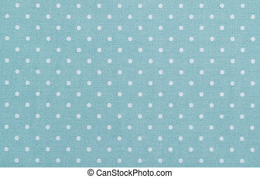 blue polka dot fabric closeup. May use as background