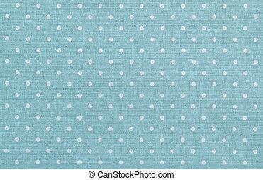 blue polka dot fabric closeup. May use as background