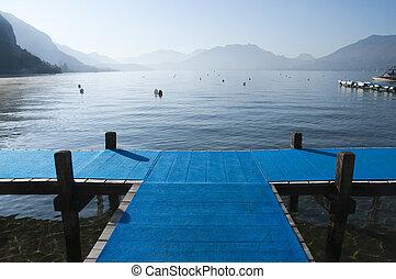 Blue pontoon Cross on lake annecy - Blue pontoon forming a...