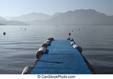 Blue pontoon on lake annecy on morning, France