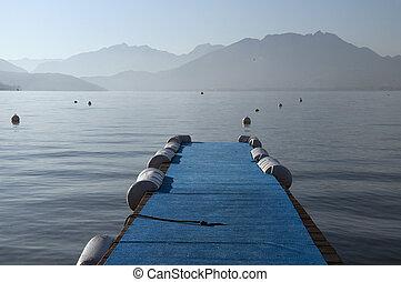Blue pontoon on lake annecy on morning, France