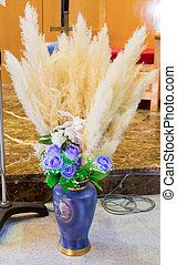 blue porcelain vase with decorative flowers