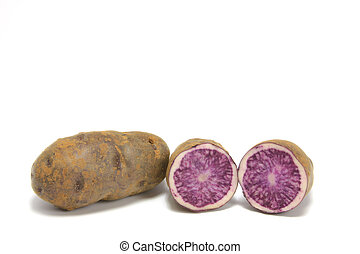 Blue Potatoes (Solanum tuberosum) isolated in front of white background