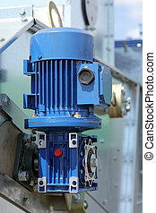 Blue powerful electric motors for modern industrial ...