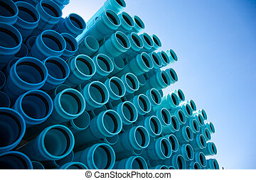 Stacks of blue PVC water pipes
