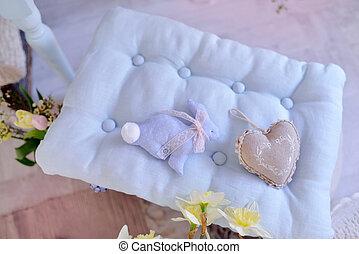 blue rabbit on a pillow