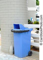 Blue recycle bin with black wheel