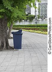 Blue recycling bin in the garden