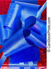 Blue ribbon on gift box