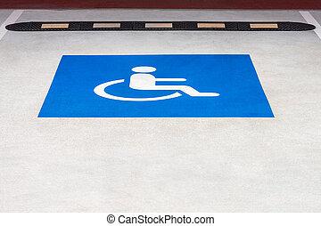blue road sign disabled parking on asphalt