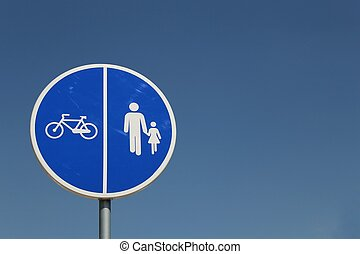 Blue road sign for bicycle and pedestrian