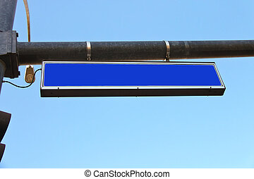 Blue road sign on a city street
