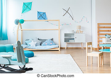 Blue rocking toy in bedroom