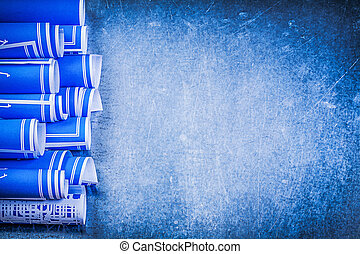 Rolled construction drawings and stainless slide caliper on blue rolled construction drawings on metallic background mainten malvernweather Choice Image