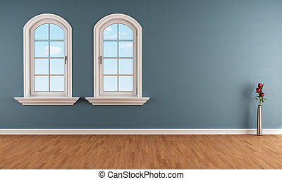Blue room with two arched windows - Two arched windows in a...