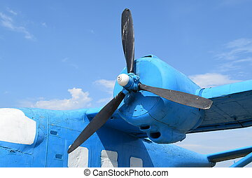 Blue rotary-wing aircraft on the hill. Open-air museum