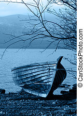 Blue row boat on shore