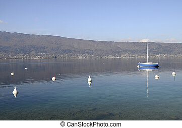Blue sailboat on Annecy lake