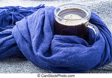 Blue scarf tied in a knot around the coffee mug close-up