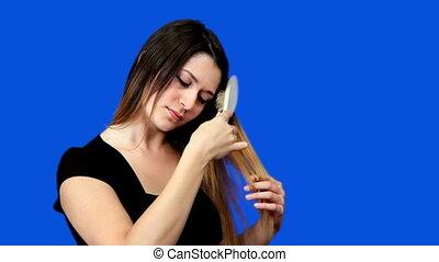 Blue screen beautiful girl comb hair