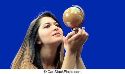 Blue screen beautiful girl hold globe sit