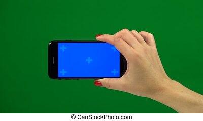 Blue screen smartphone in hands. Green screen - Blue screen...